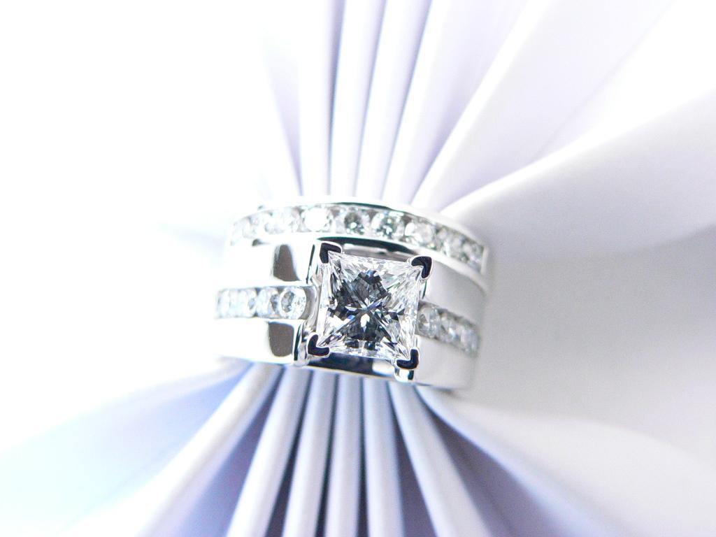 Princess cut diamond center stone diamond engagement ring.