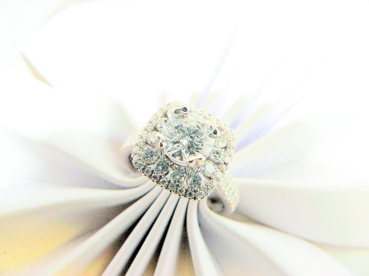 Rounded corner halo diamond engagement ring