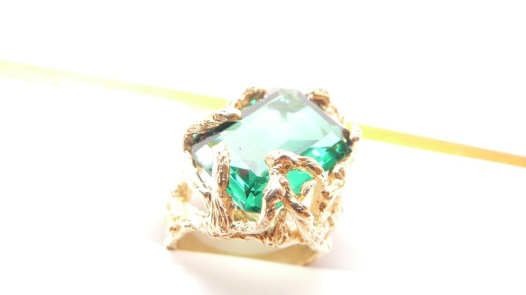Colored gem stone ring on yellow gold