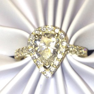 custom made pear shape halo engagement ring michigan
