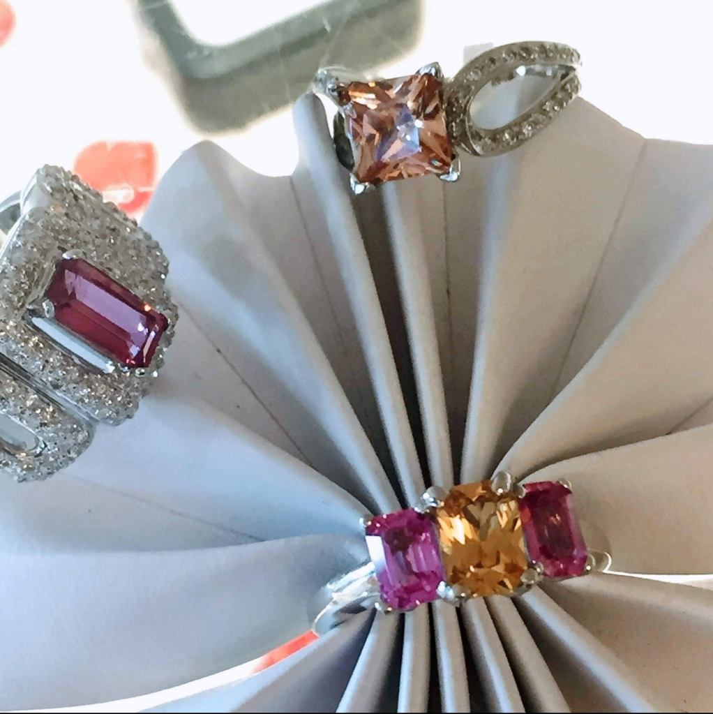 Pink and yellow sapphire and diamond rings
